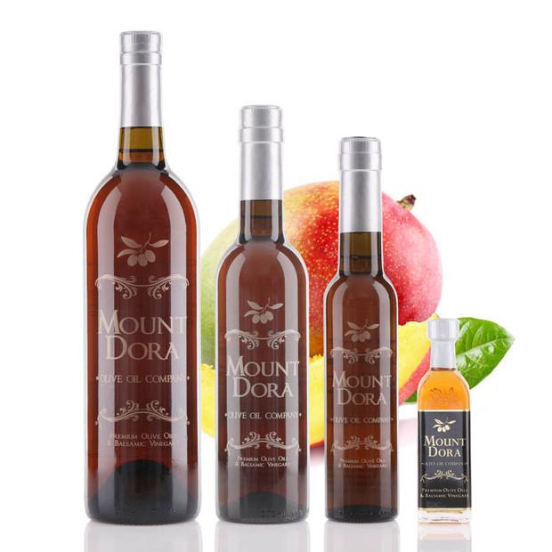 Four different size bottles of Mount Dora Alfoos Mango White Balsamic Vinegar