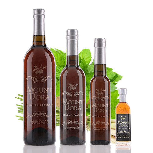 Four different size bottles of Mount Dora Lemongrass Mint White Balsamic Vinegar