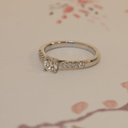 18ct White Gold 0.68ct Brilliant Cut Diamond Ring With Diamond Shoulders