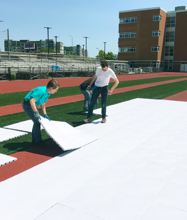 EverBlock Flooring People Laying Floor Tiles