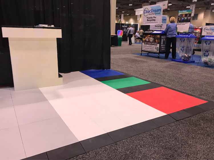 Colorful floor tiles being used at a tradeshow