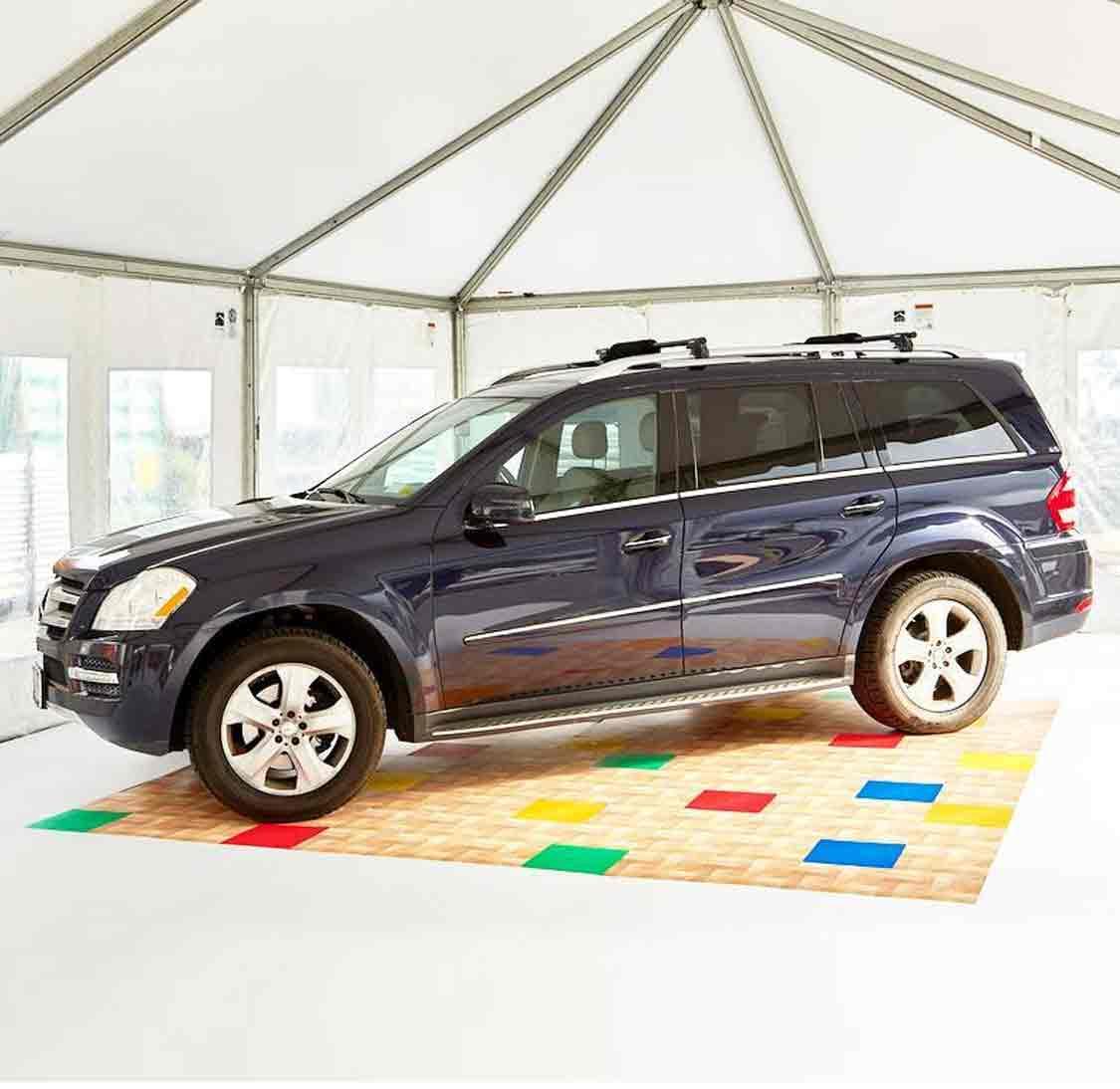 A car on top of EverBlock Flooring tiles