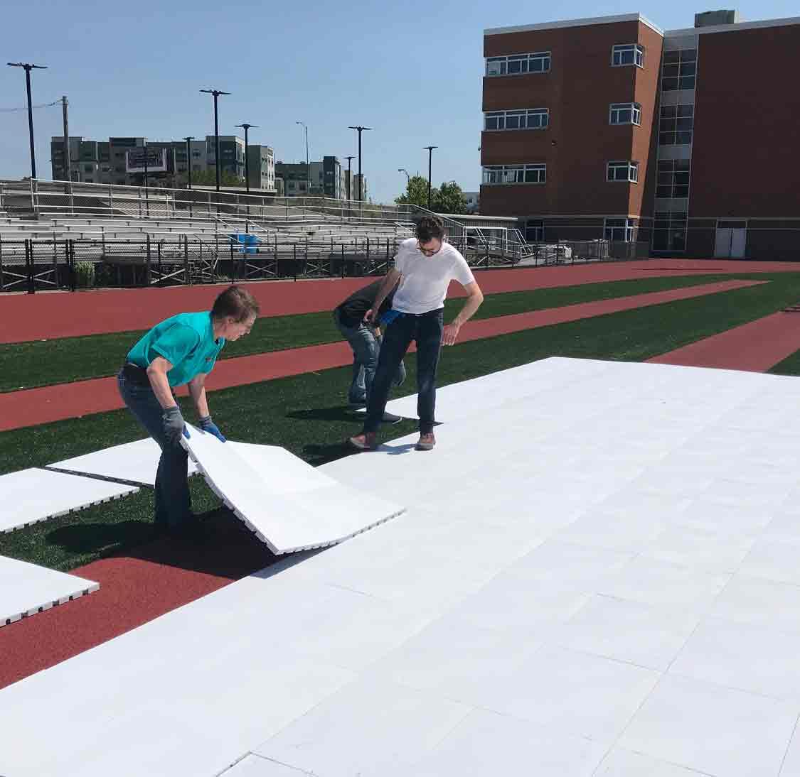 Installing EverBlock flooring on stadium turf