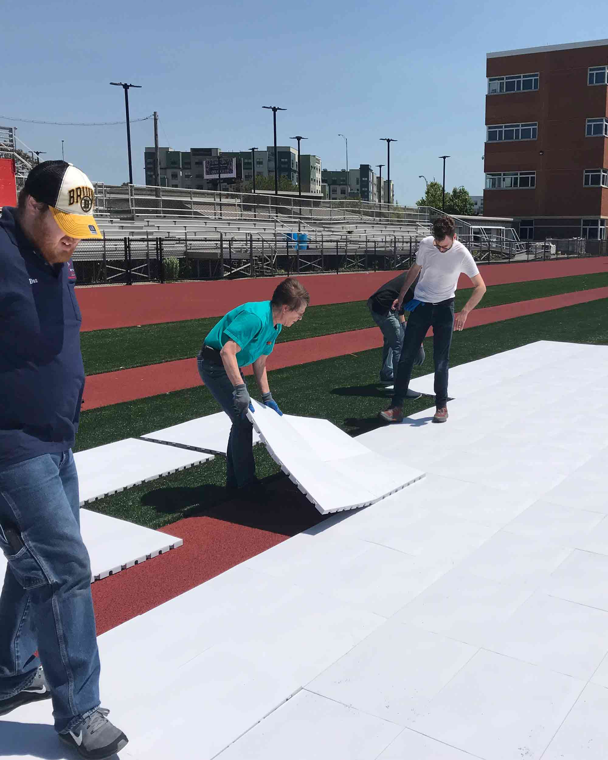 Installing EverBlock Flooring on top of Stadium Turf for protection