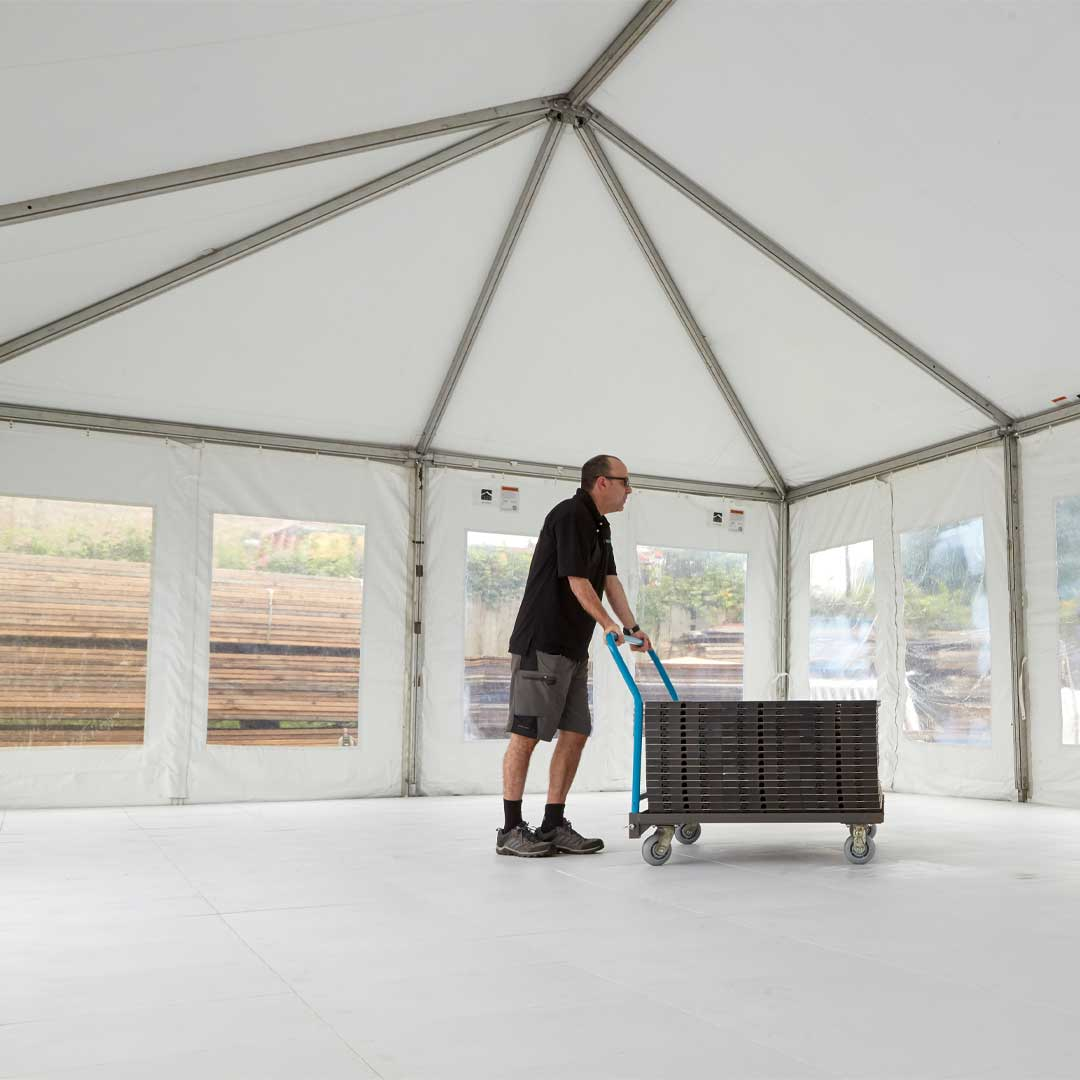 EverFlooring in a tent being transported on the EverBlock transport cart