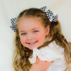 The Harper houndstooth hair bow is perfect for pigtails!
