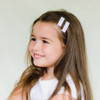 Toddler Barrette White with Rainbow Stitches
