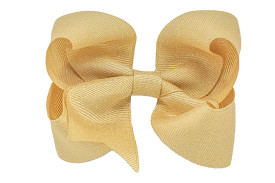 Our big gold hair bow is dressy and perfect way to complete her holiday outfit