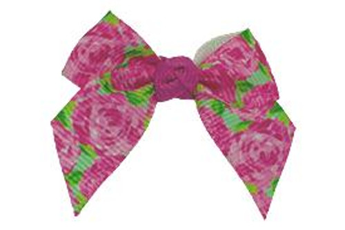Our Rosanna baby bow is the cutest must have staple! The first impressions inspired print has all the pinks, this bow goes with everything!
