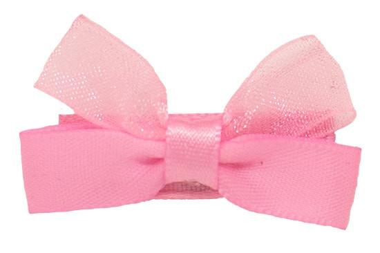 Pink Kara baby hair bow shown on bitty clip