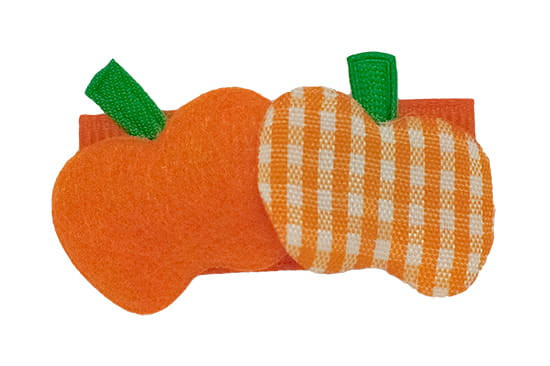 Solid orange and gingham pumpkins shown on a snap clip