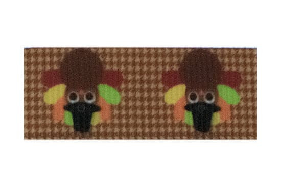 This brown gingham turkey hair clip is a must-have for Thanksgiving.