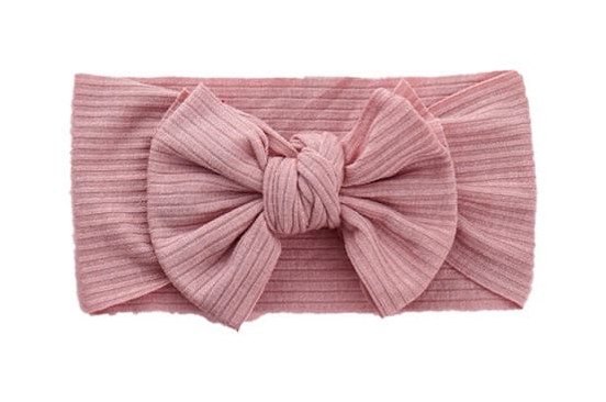 Our Cindy fabric stretchy baby headband bow is adorable, shown in quartz