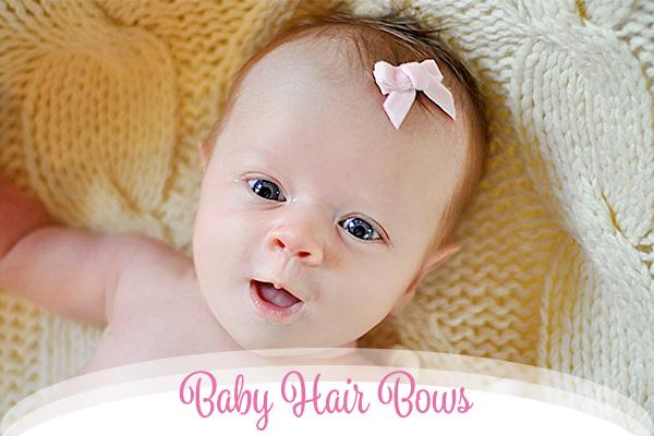 Mackenzie pink velvet baby hair bow shown on a fine haired infant