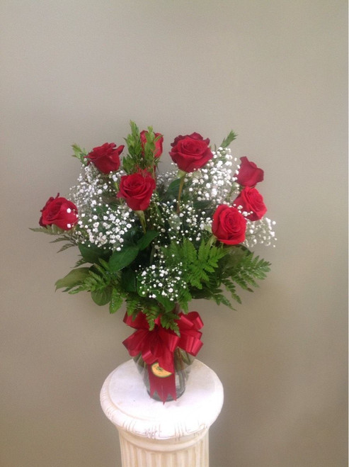 Our Classic Dozen rose stands around 3ft tall and features baby's breath and a lavish Bow!
