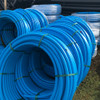 32mm blue MDPE pipe coils (50m shown).