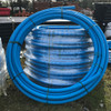 63mm blue MDPE pipe coils (50m shown).