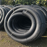 Coil of 160mm land drain.