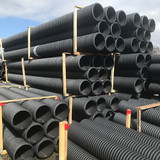 Bundle of 300mm perforated pipe.