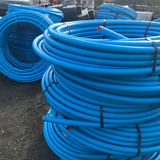 Coils of 25mm blue MDPE (50m shown).