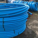 Coils of 50mm blue MDPE (50m shown).