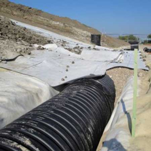 Non-woven geotextile over twinwall pipe.