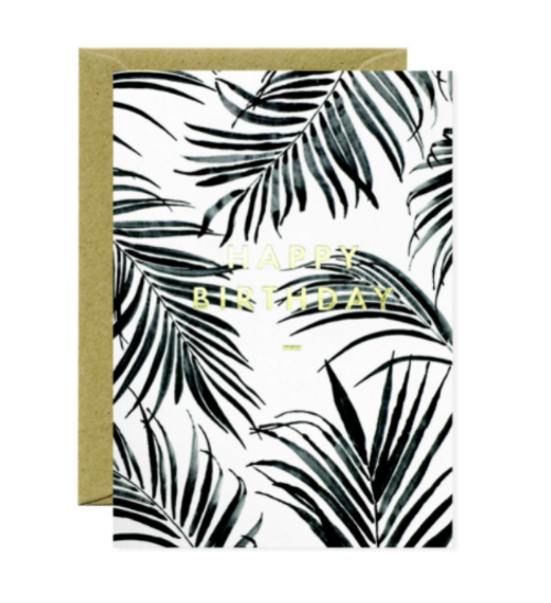 Gold foil Happy Birthday on black and white palm tree print.