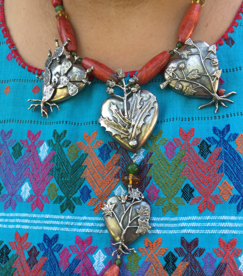 Sterling Silver necklace designed by Flora María, includes four exquisite hearts, each depicting a different type of cactus. Flora Maria captures the beauty of Mexico's nature through elegant pieces that use the silver and stones of the country. This one is strung with