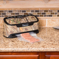 Magic Chef Vacuum Sealer in use