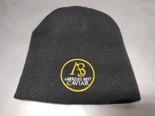 """For those cold weather months, enjoy this everyday  style beanie that is just right for you.  Complete with  an embroidered center logo, you can be warm """"in style""""  with this cold weather beanie."""