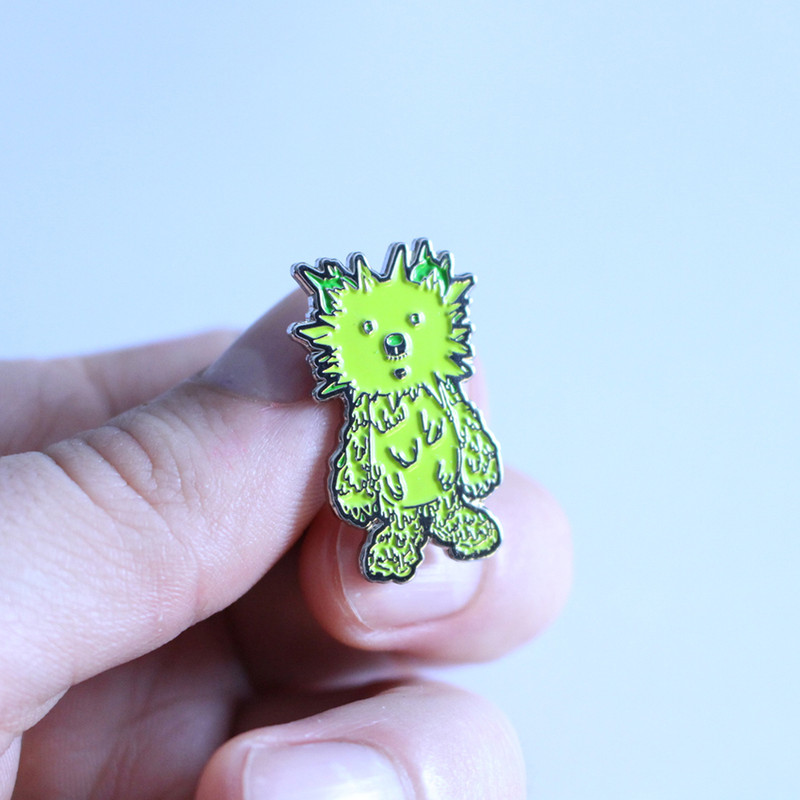 INC. Pin : Green and Silver