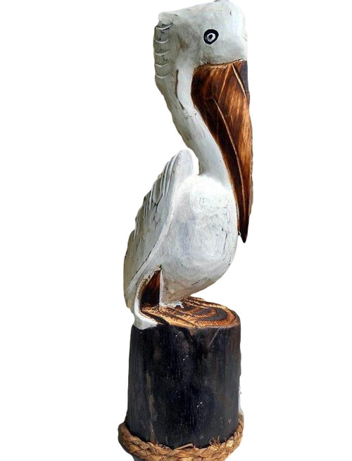 Carved  White Pelican on a pier post.  Nautical Seasons