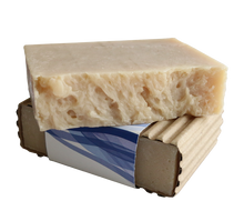 This handmade beauty bar uses natural antioxidants to deliver ultra-moisturized skin.  No dyes, lanolin, sulfates, or formaldehydes, and no added fragrance — only the scent of the bar's all natural ingredients: saponified oils (olive, soybean, palm, and shea butter), grape seed oil, and red wine.