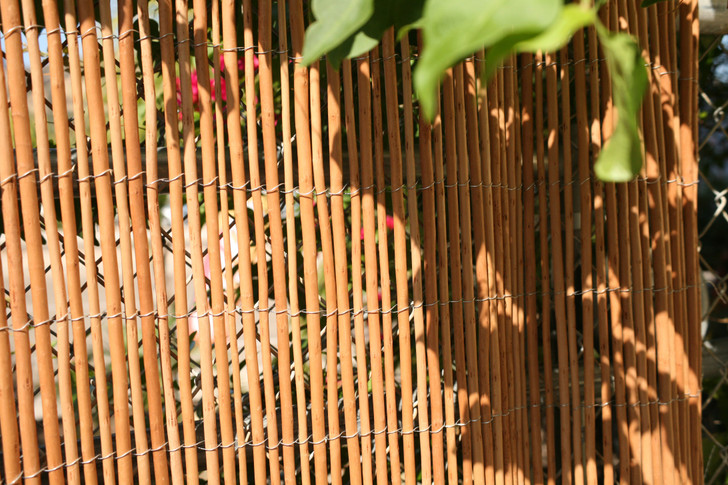 8 ft. L X 6 ft. H Carbonized Willow Rolled Panel Fence