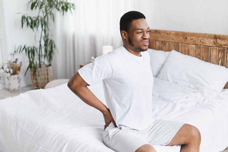 Man Experiencing Back Spasm