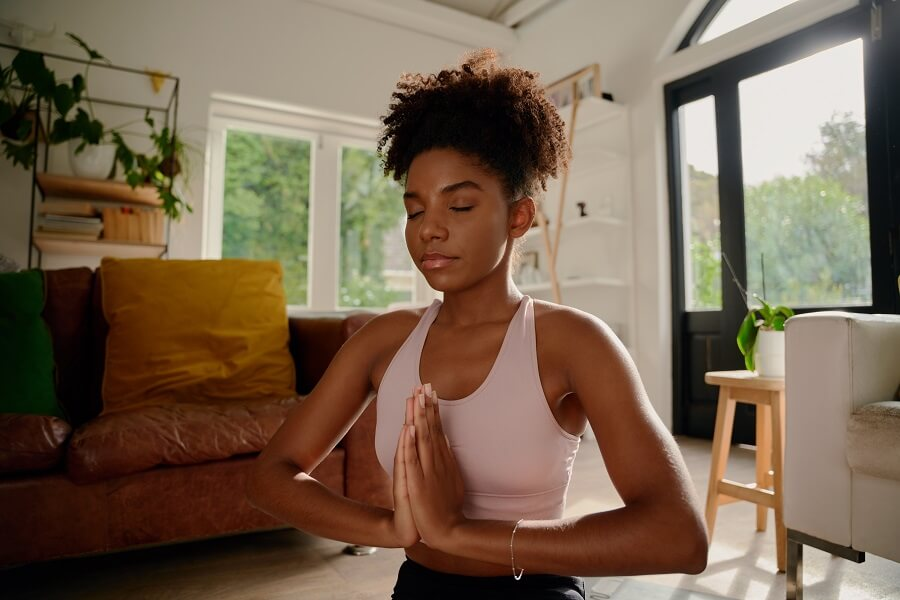 Woman Controlling Her Breathing During Yoga