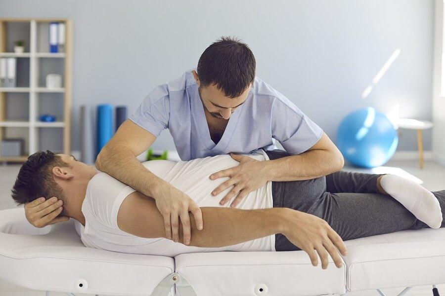 Man Visiting a Chiropractor