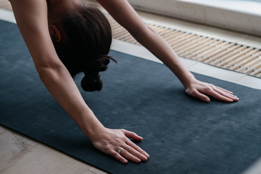 Woman Practices Hot Yoga