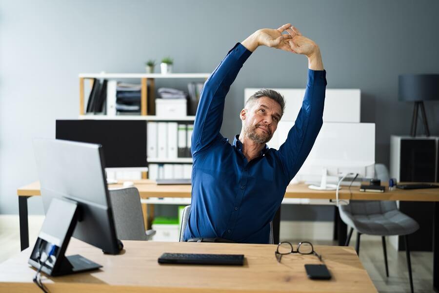 Man Stretching While At Work
