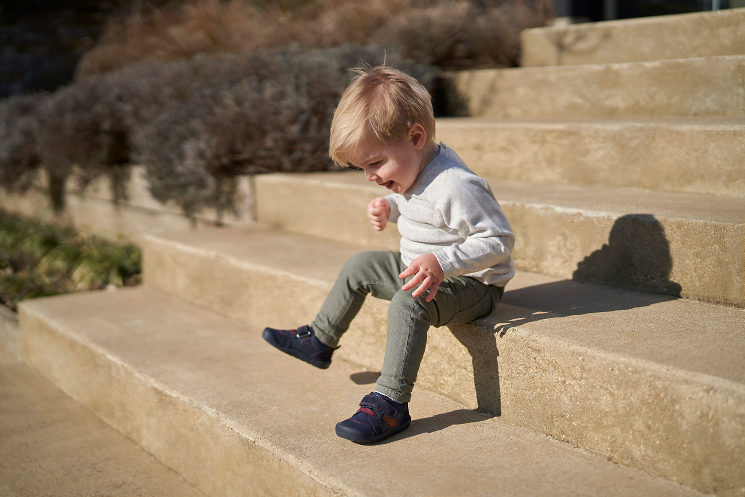 Boy Sitting on Steps