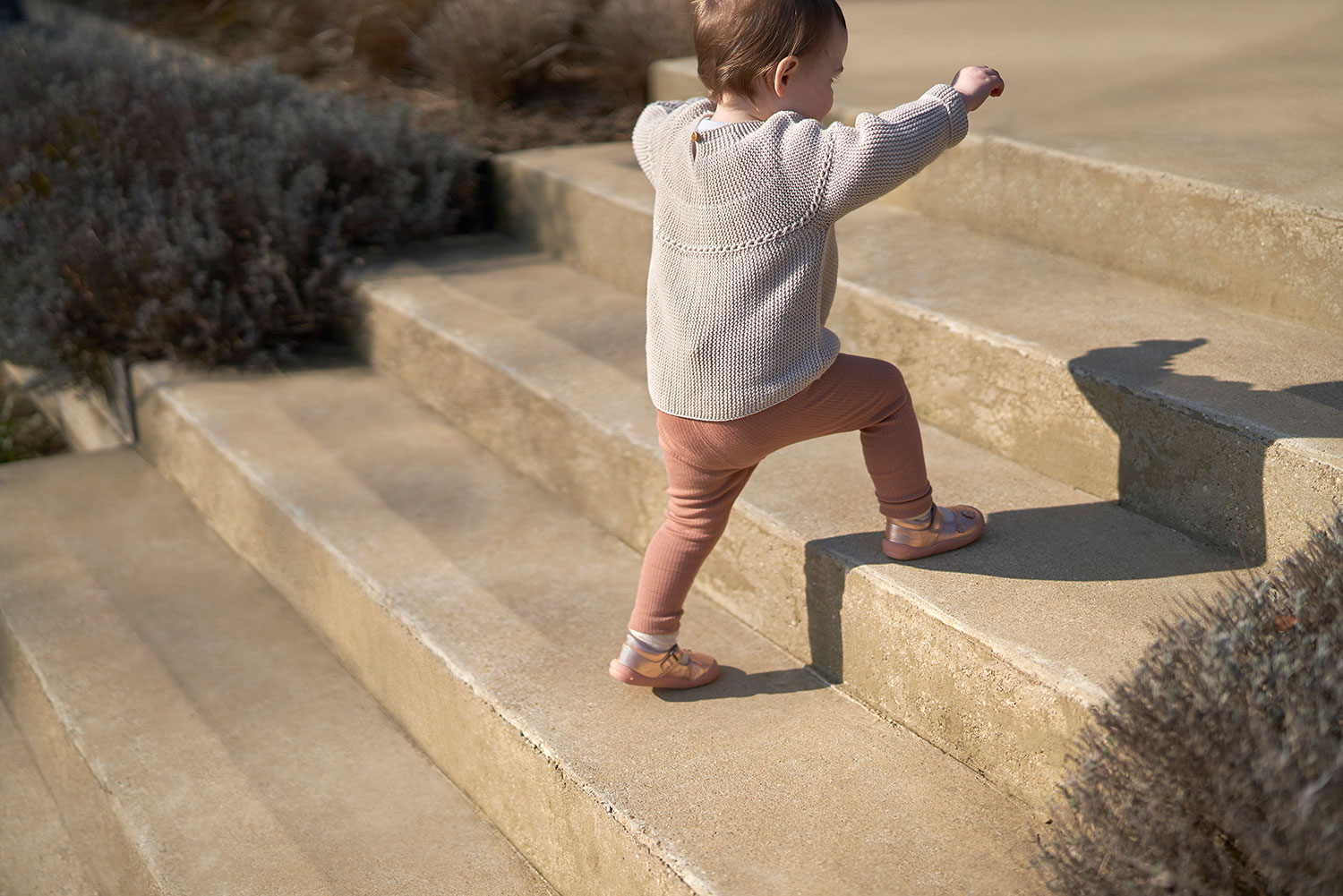 Girl Walking up Steps