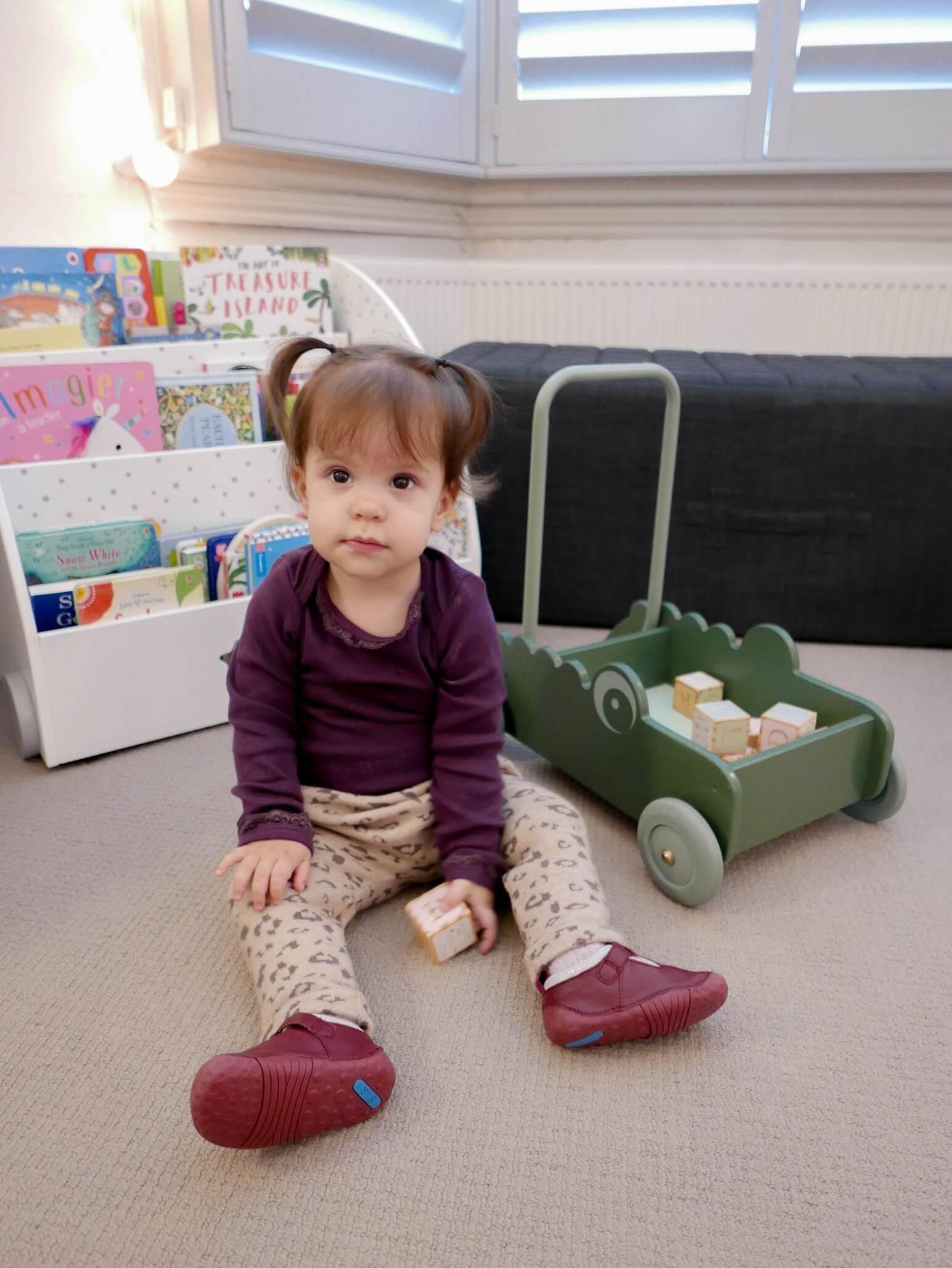 Clara wearing baby shoes