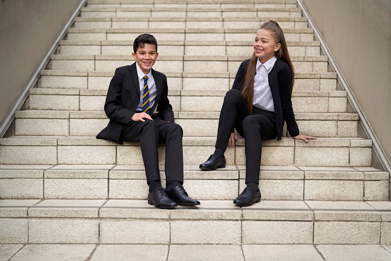 School Kids Sitting on Steps