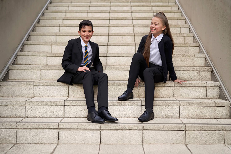School Kids Sitting on Steps