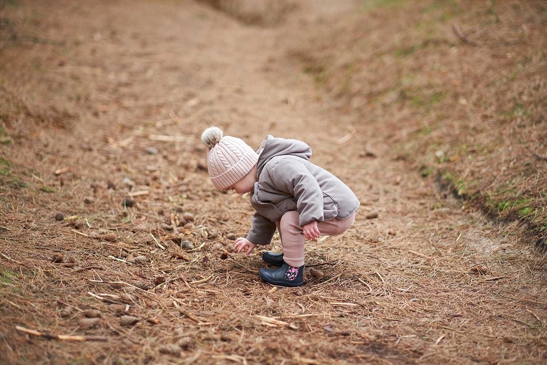 Girl Finding Pine Cones
