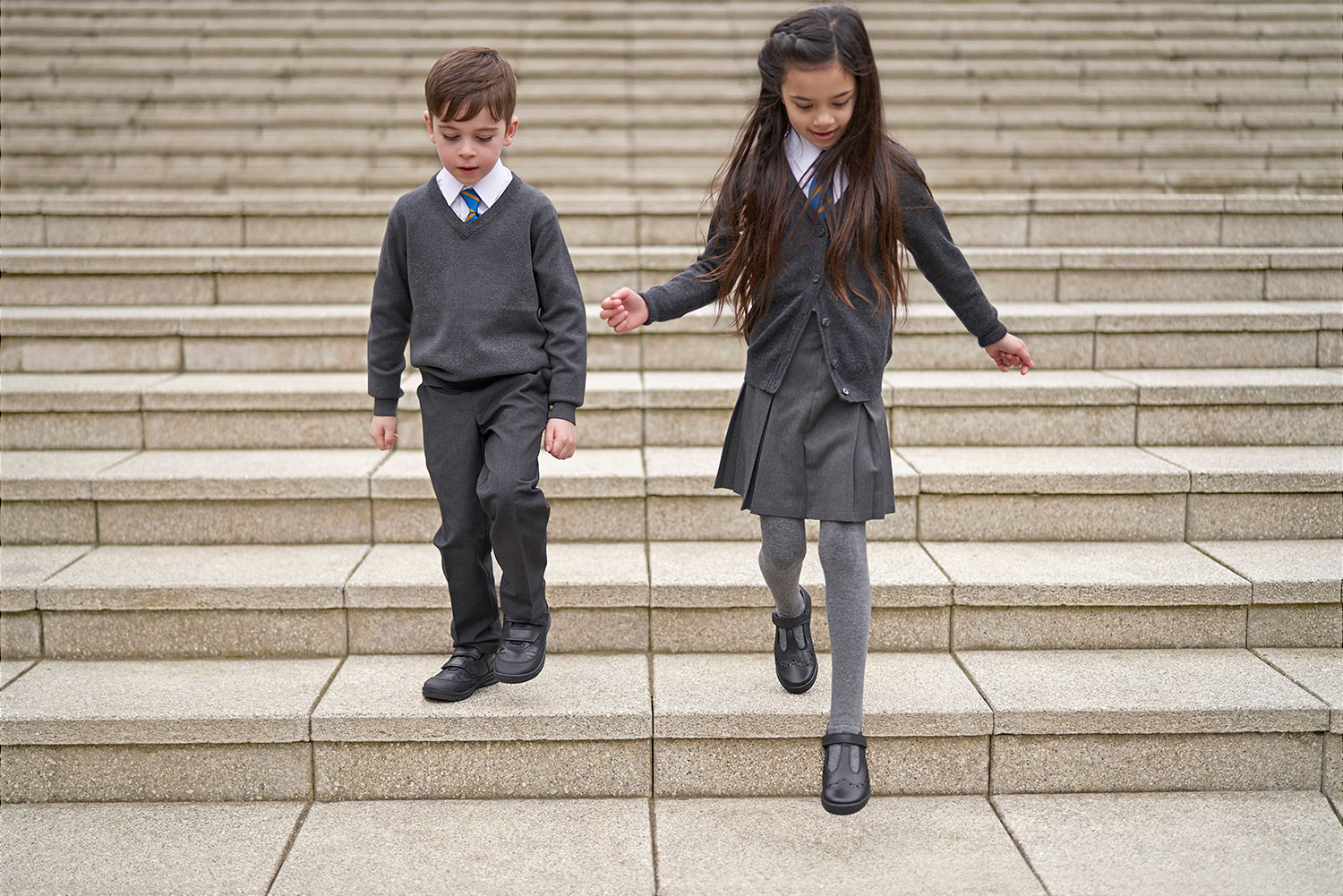 Schoolgirl and Schoolboy on Steps