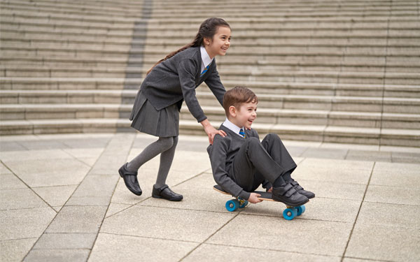 Boy and Girl Playing on Skateboard