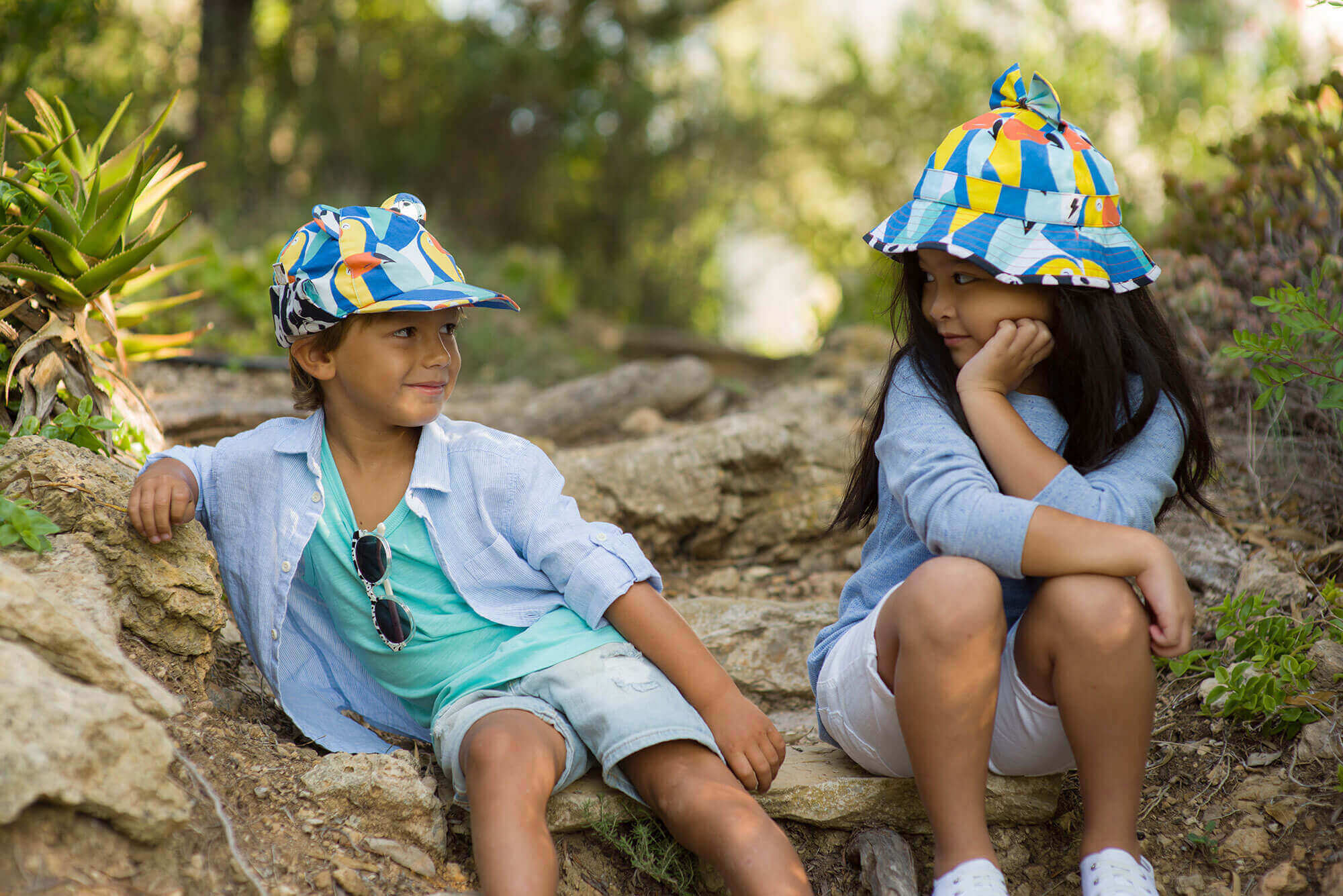 Girl and boy wearing summer hats