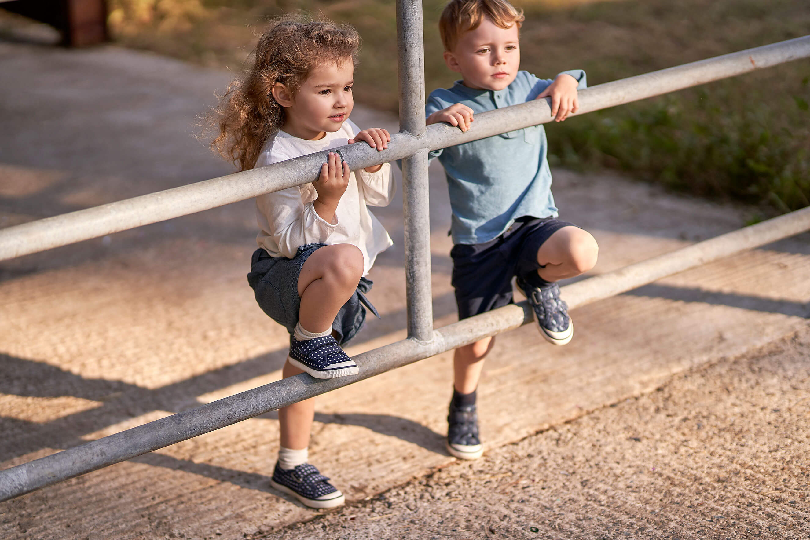Girl and boy wearing canvas shoes