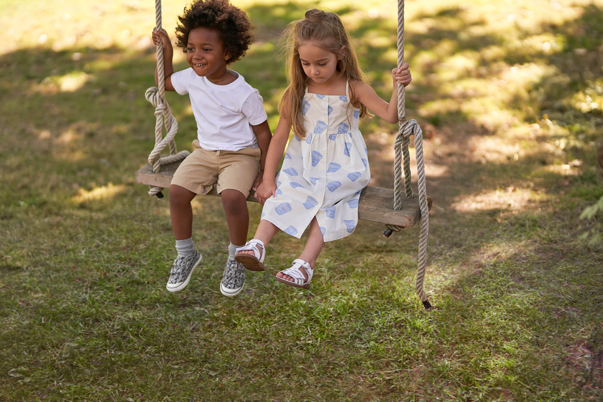 Boy and girl on rope swing
